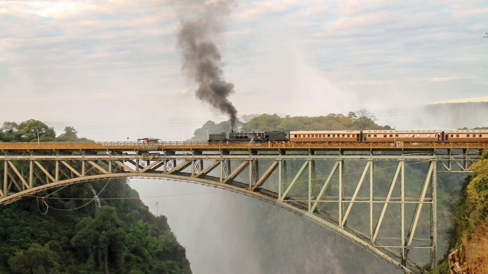 train-crossing-famous-victoria-falls-bridge-in-zimbabwe-1600x900